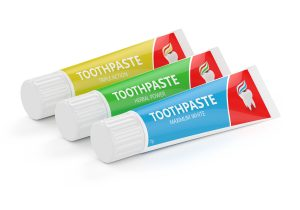 three tubes of toothpaste