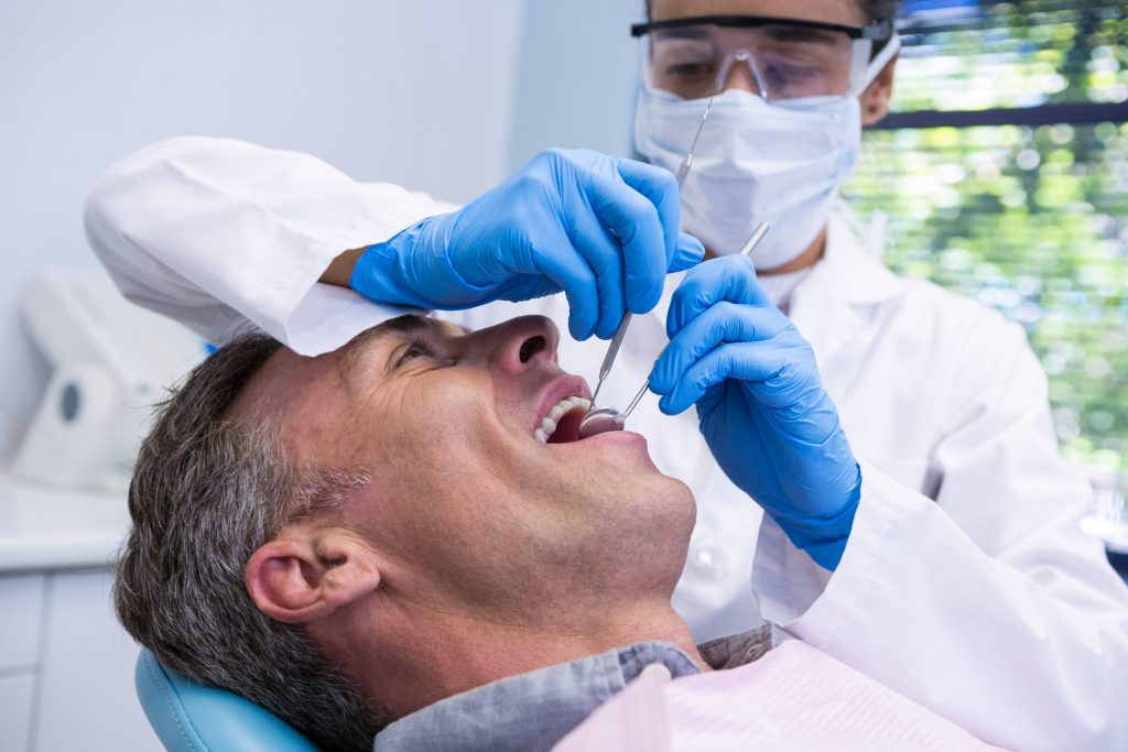 man mouth open for root canal