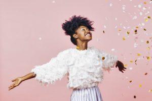 Happy woman throwing glitter