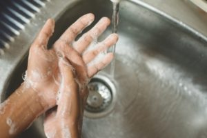 dentist in Upper Arlington washing their hands