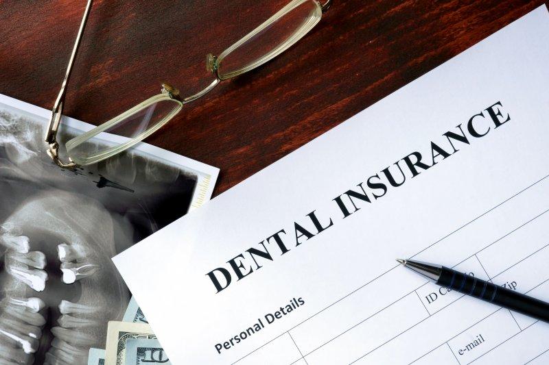 Dental insurance paperwork on table