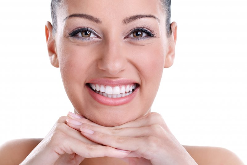 a woman showing off her smile after receiving cosmetic dentistry in Upper Arlington