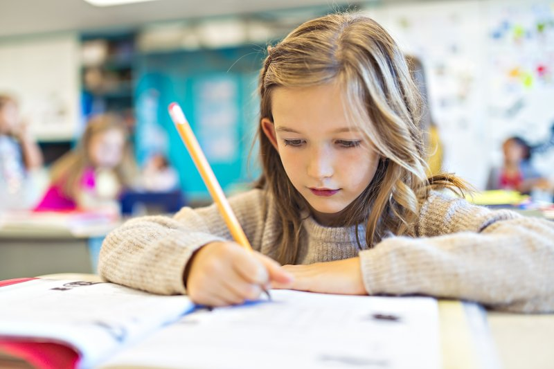 young girl studying in classroom